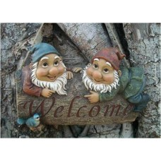 Gnomes Hanging On a Welcome Sign
