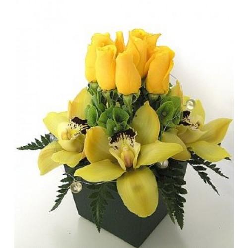 Cymbidium Flowers and Roses in Black Vase